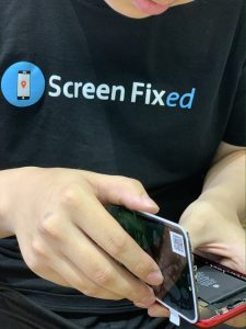 Screen Fixed technician repairing iphone 11